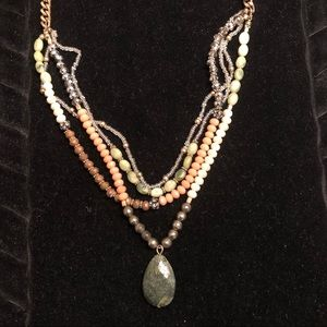 Beaded statement necklace with green stone center
